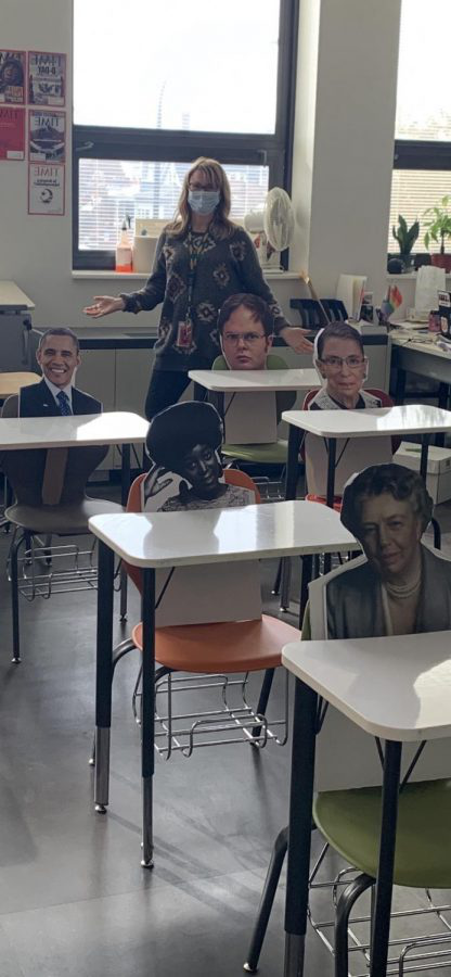 Ms. Rohde teaches to famous cardboard cut-outs in lieu of her missing students.  Ms. Doogan produced the cut-outs for Ms. Rohde in her graphic arts class.